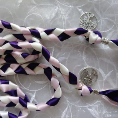 Purple, light pink and white ribbons used with a silver tone tree of life charm